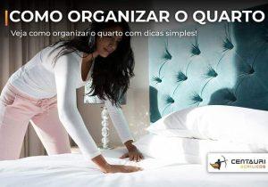 mulher organizando a cama do quarto